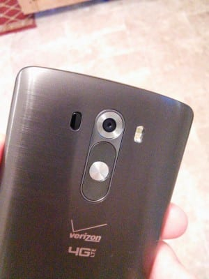The backplate of the LG G3, displaying the volume keys, power button at the center, and camera.