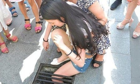 Girl_gets_stuck_in_stormdrain