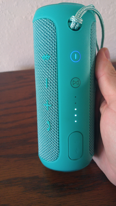 Buttons, ports, battery indicator, power connection and Bluetooth indicator all rest on the back of the speaker.