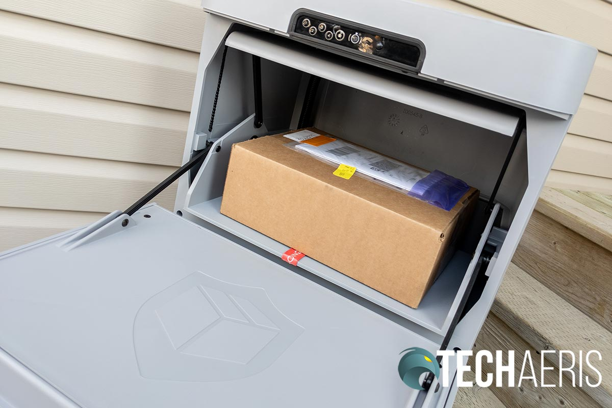 The Danby Parcel Guard Smart Mailbox with a package for delivery