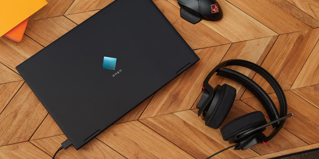 HP OMEN 15 laptop, gaming headset, and gaming mouse on desk