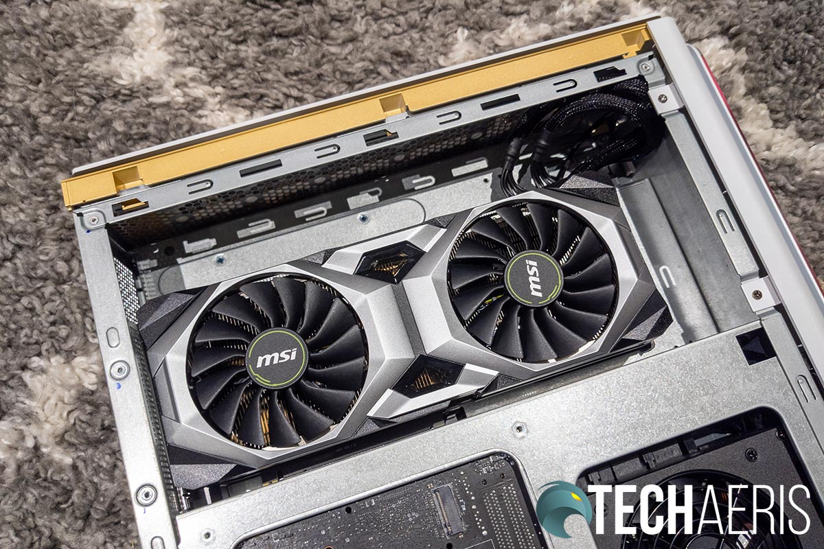 The left side of the the MSI P100 Prestige 8929 desktop computer with the panel removed showing the MSI GeForce RTX™ 2080 Ti 11GB GDDR6 graphics card