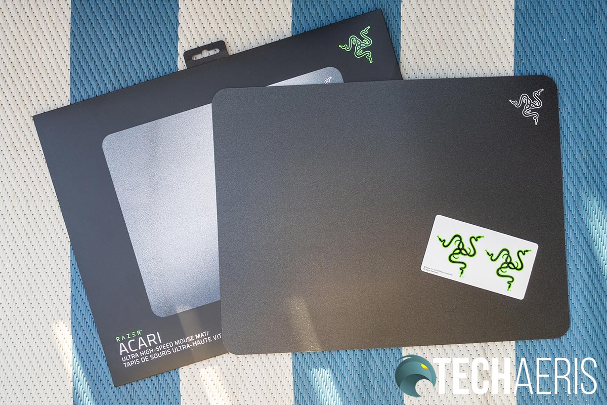 The Razer Acari mouse mat with Razer stickers and packaging
