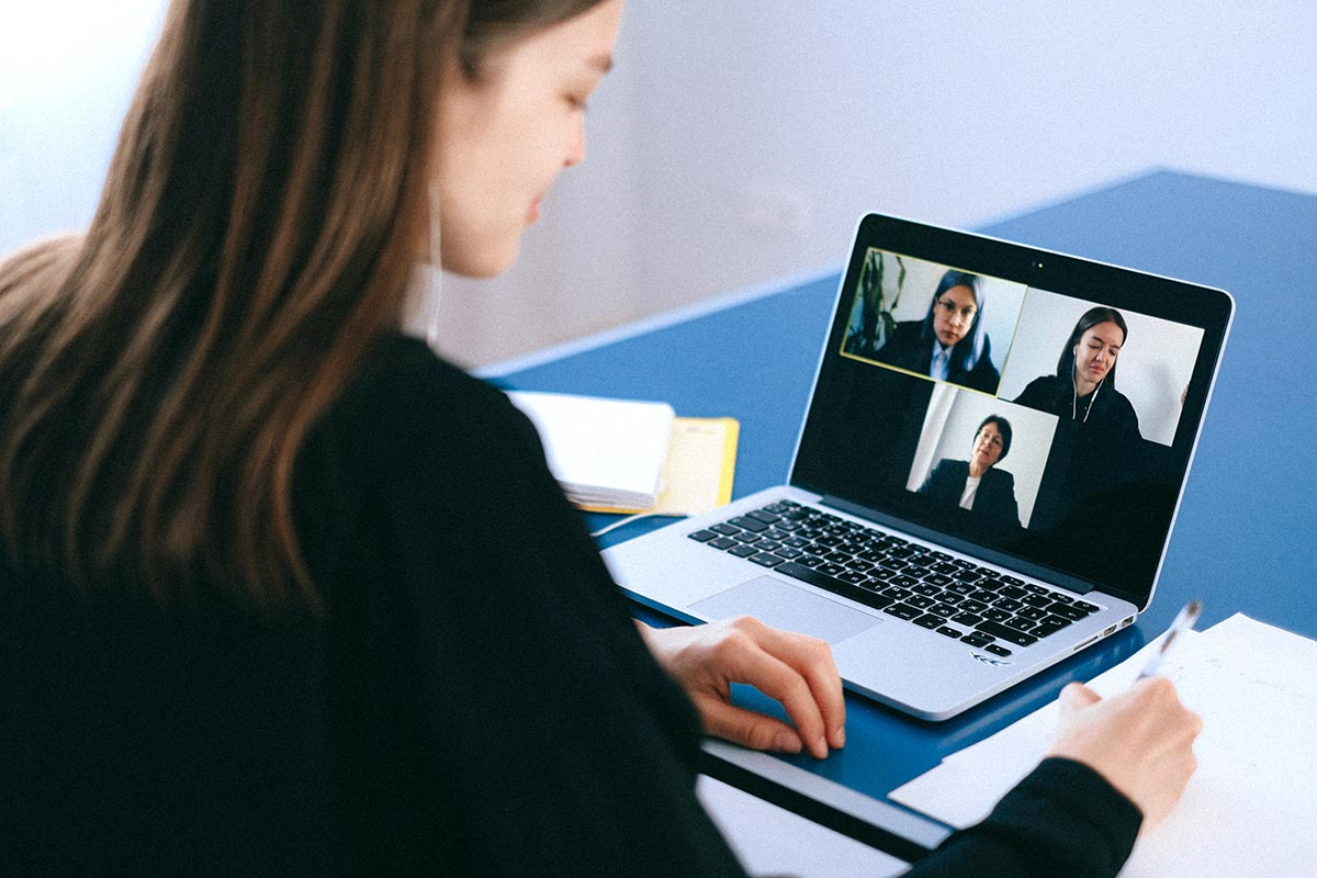 Woman on laptop video conferencing