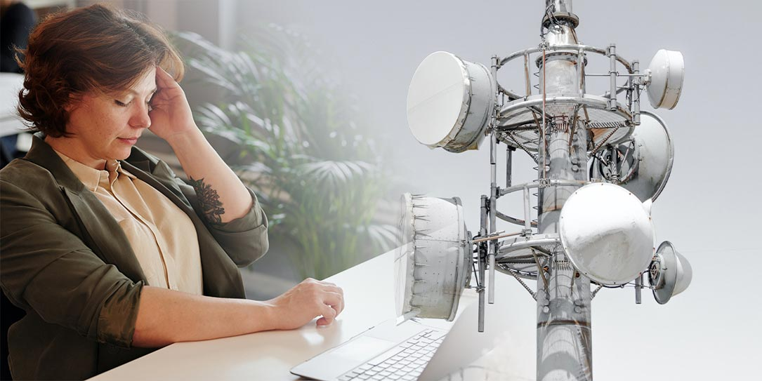 woman with headache and 5G tower composite image