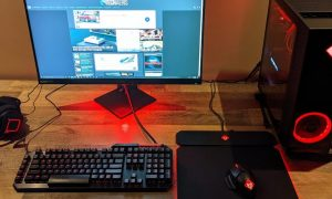 The HP OMEN 30L gaming desktop with OMEN 27i gaming monitor and peripherals