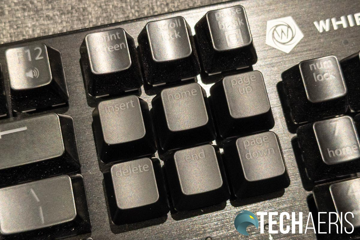 The default (glossy) keycaps versus the newer matte keycaps on the Whirlwind FX Element mechanical gaming keyboard