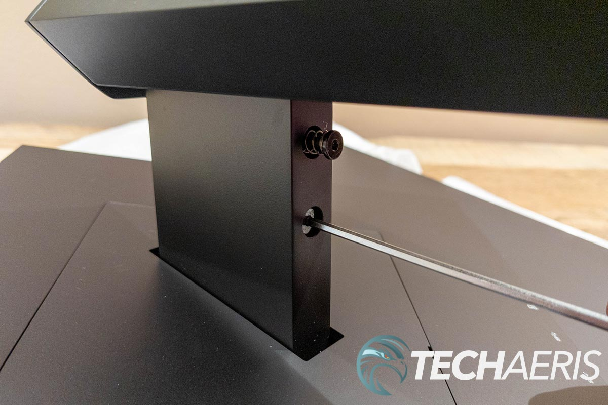 Attaching the monitor stand to the HP OMEN 27i gaming monitor with the included Allen key