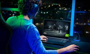 Razer Blade Pro 17 gaming laptop with gamer playing Call of Duty