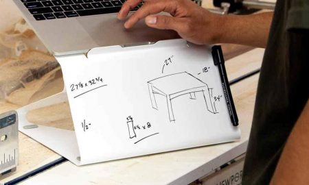 Fluidstance The Lift whiteboard laptop stand in carpenter shop