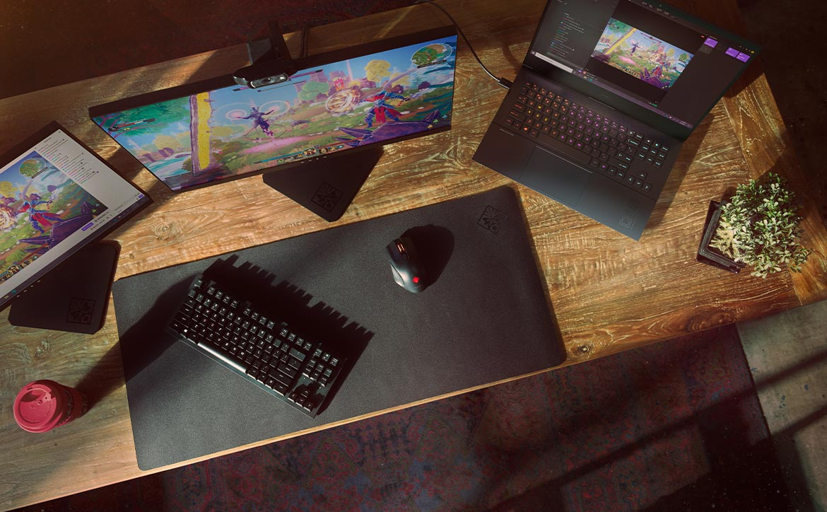 HP OMEN gaming laptops with monitors on desk