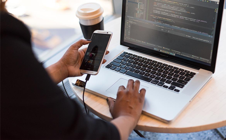 improve mobile app computer laptop smartphone desk coffee