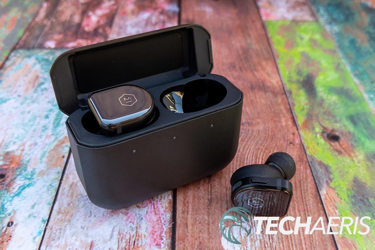 The Master & Dynamic MW08 true wireless earbuds with the included stainless steel charging case