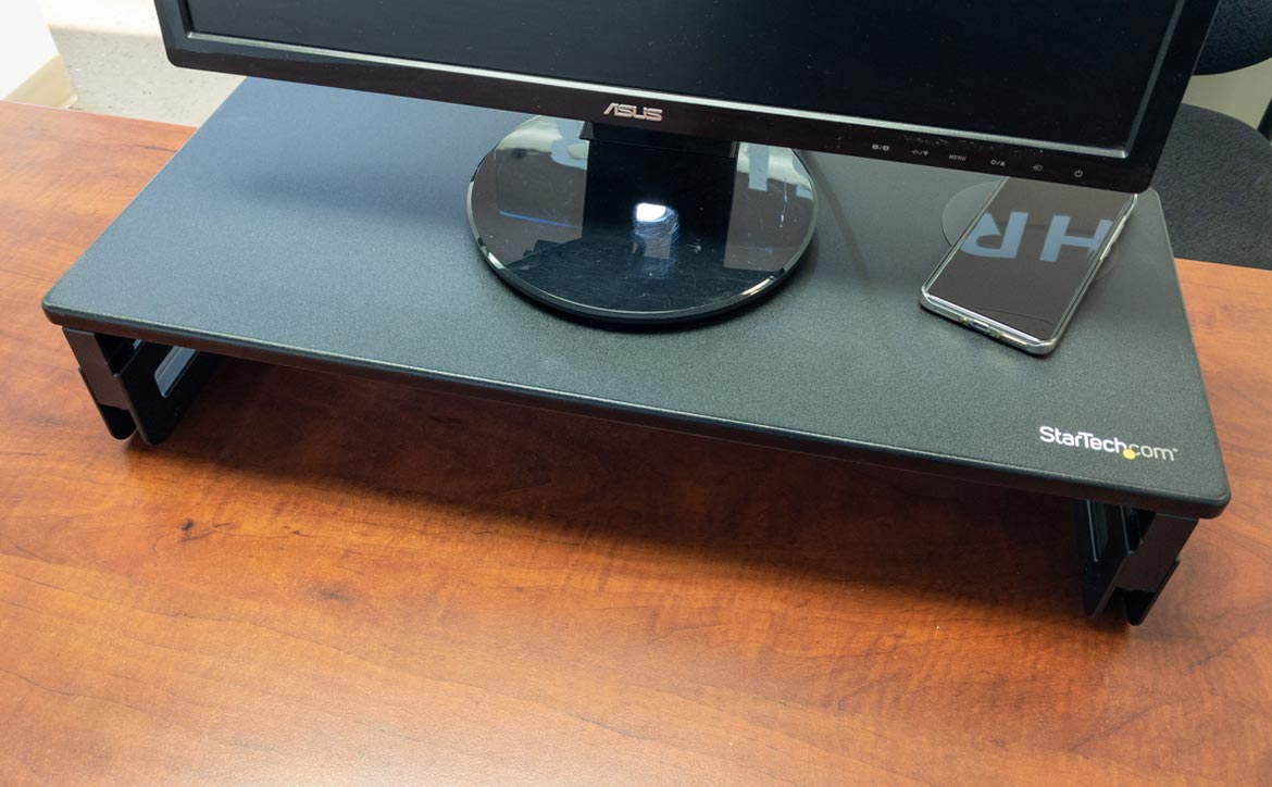 The StarTech Monitor Riser Stand with Wireless Charging Pad