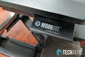 The levers on the side of the Ergotron WorkFit-TX standing desk converter
