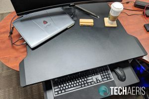 "The Ergotron WorkFit-TX standing desk converter with laptop and 35"" monitor"