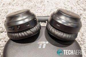 The controls and ports on the bottom of the TaoTronics SoundSurge 60 Active Noise Cancelling Wireless Stereo Headphones earcups