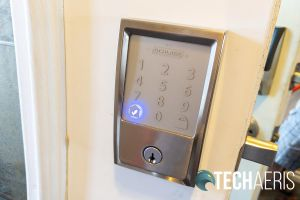 The checkmark indicates the code entered is correct or locking is complete on the Schlage Encode Smart Wi-Fi Deadbolt