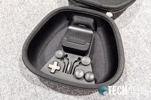 The included carrying/charging case with charging brick
