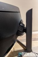 The Samsung Odyssey G7 curved gaming monitor adjusts up and down for height