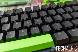 The front of the Doubleshot PBT keycaps the Razer Huntsman Mini 60% Optical Gaming Keyboard have secondary functions printed on them